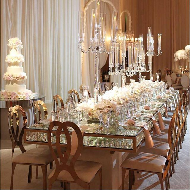 Infinity Rose Gold Chairs and Crystal Chandelier Glasstop tables ...