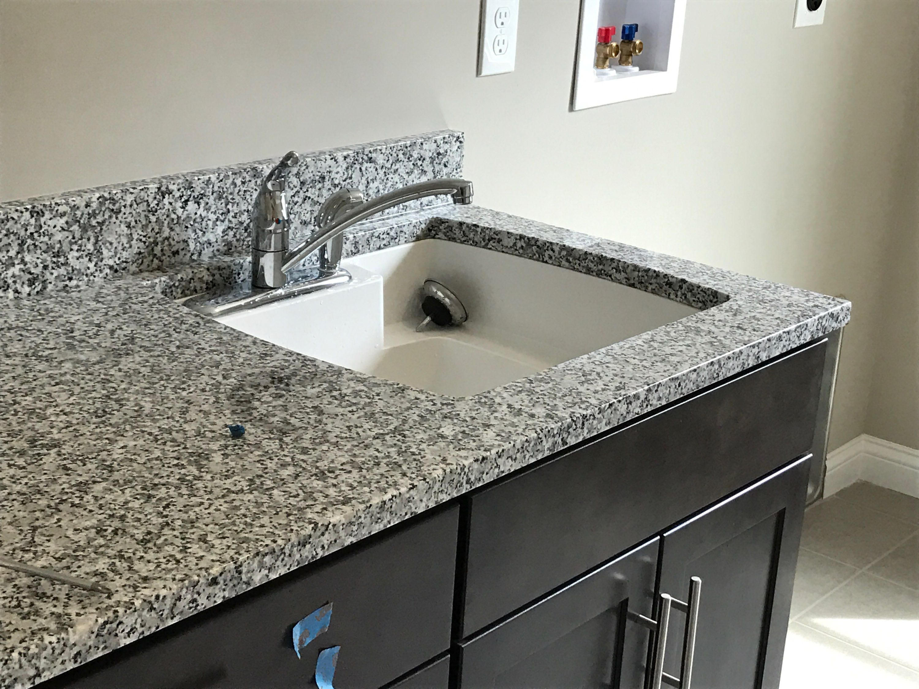 Undermount White Latitude Sink With Standard Chateau Faucet In Laundry