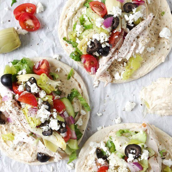 These easy and delicious Greek Hummus Wraps are piled with chicken and fresh veggies for a healthy summer dinner. Takes just 15 minutes!