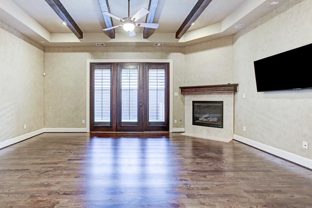 1212 Bell St. Inviting First Floor Living Room Boasts Plaster Accented  Walls, Wood Beams