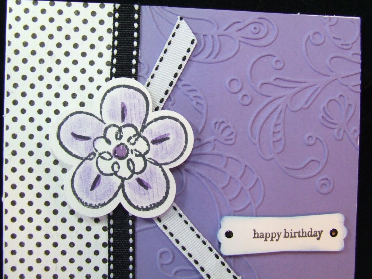Handmade birthday card embossed using stampin up flower fest