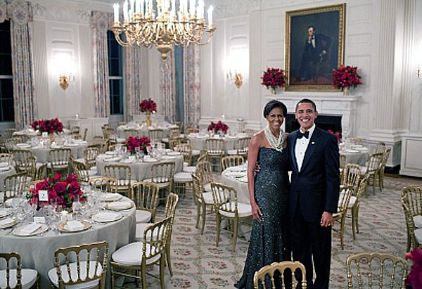 President Barack Obama And First Lady Michelle Pose In The State Dining Room Of White House Before Governors Dinner Feb