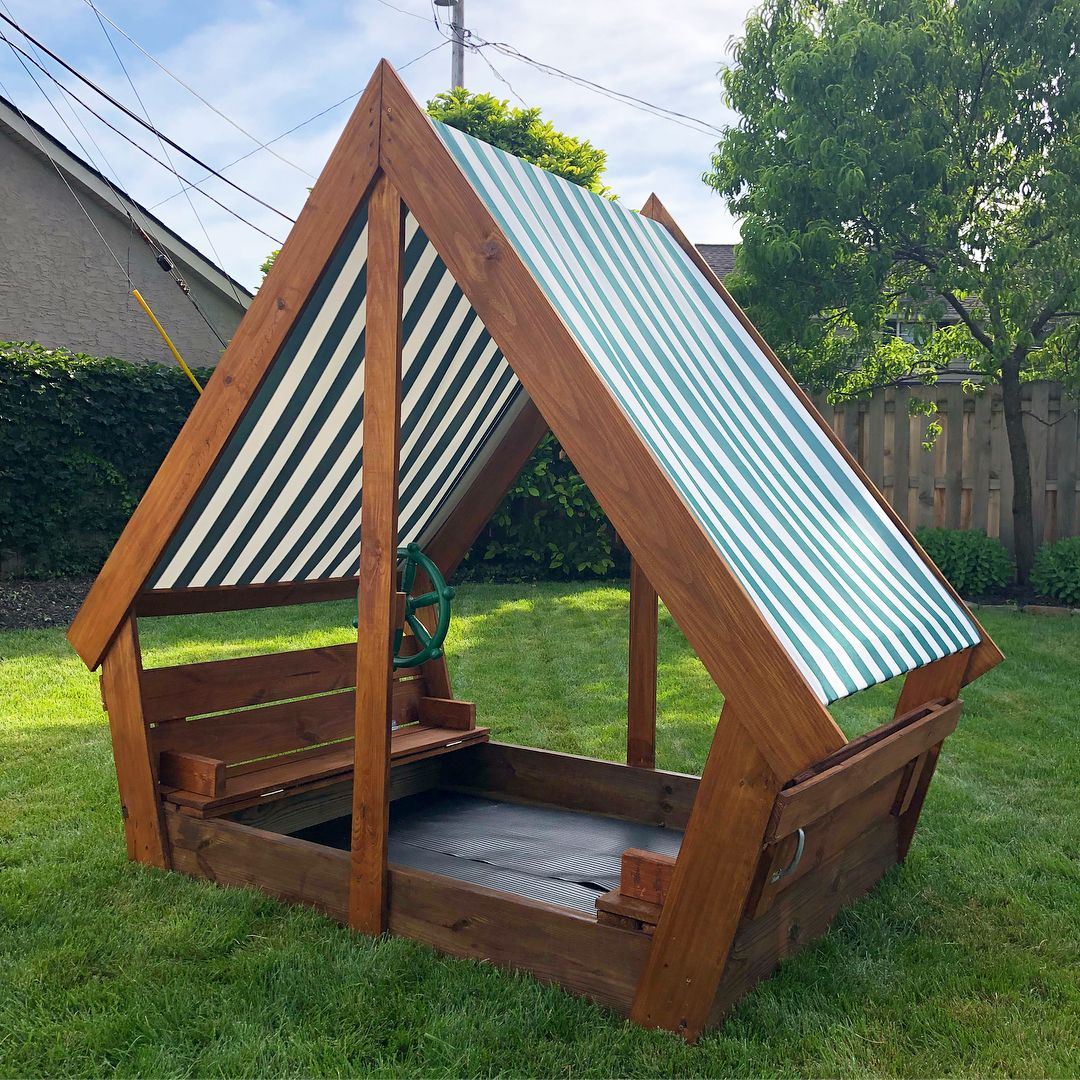 Diy wooden sandbox with waterproof overhang covered to