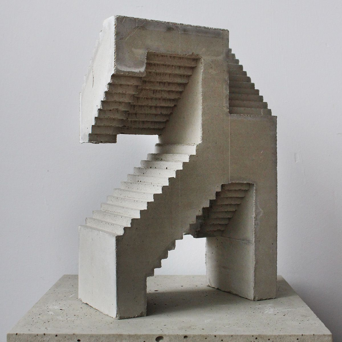 Concrete contemporary sculpture inspired by primite arts. The ...