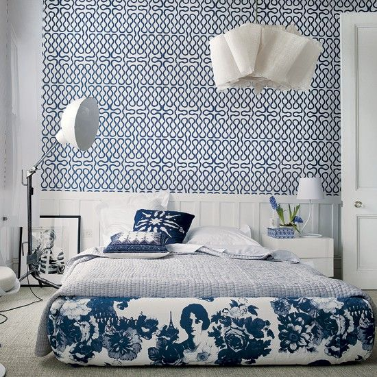 Modern blue and white bedroom - great wallpaper with the board and