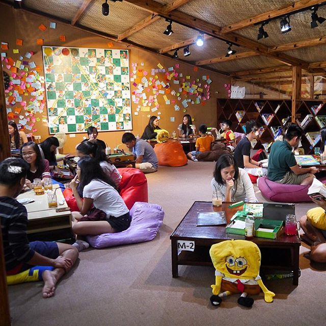 Low Seating Area Carpet Or Turf Low Level Tables Low Level Bean Bags Game Cafe Board Game Cafe Board Games