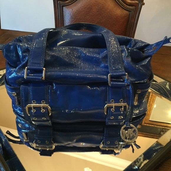 MK limited edition blue patent leather bag Limited edition intense blue patent leather MK purse. In excellent condition except for the small whole in the interior lining of the purse. Very well taken care of! Duster bag included. Michael Kors Bags