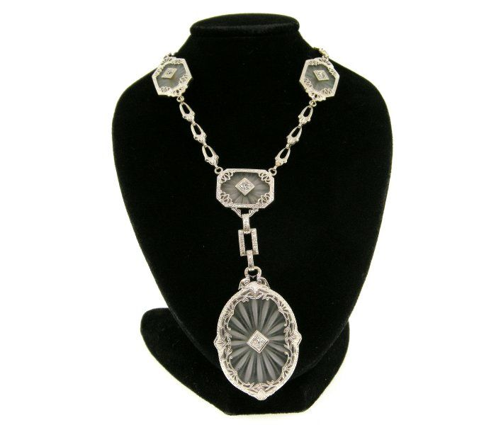Art Deco 14KT all engraved white gold Rock Crystal necklace with sun ray etching and accented with Single cut diamonds [...]