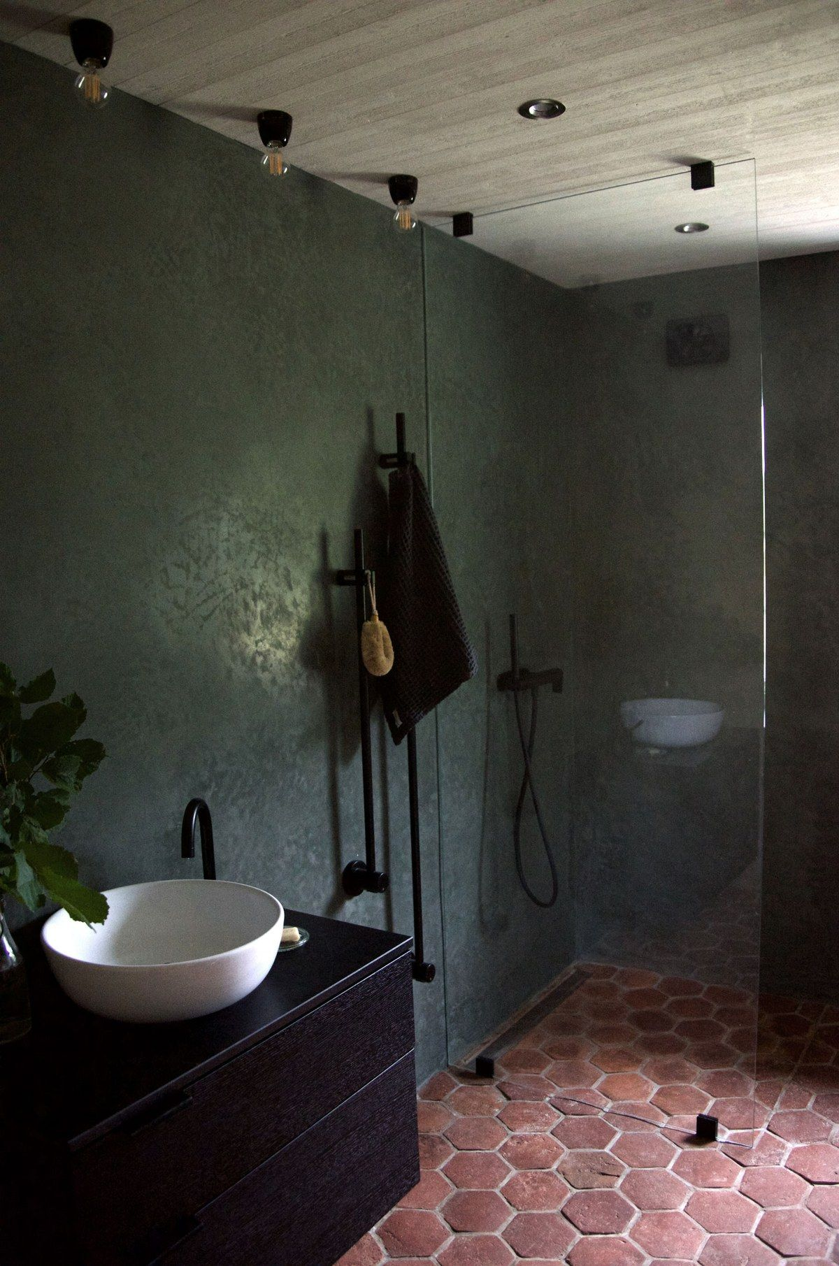 The 7 Green Building Techniques We Used To Design Our Dream Home Architectural Digest Green Bathroom Dark Green Walls Bathroom Interior