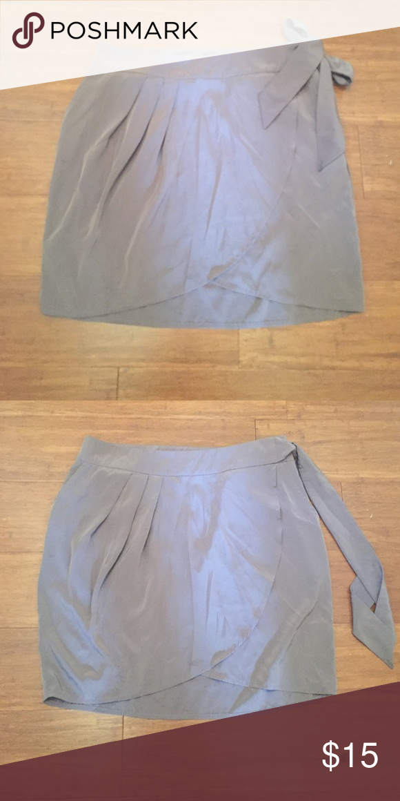 H&M mocha colored skirt with waist tie Falls about 2' above the knee. Side zip and button closure. 100% polyester. H&M Skirts