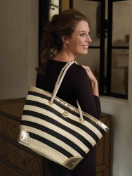 Black striped straw tote bag with scalloped vegan leather accents and rope handles. Polka dot printed cotton lining with interior pockets and magnetic snap closure.