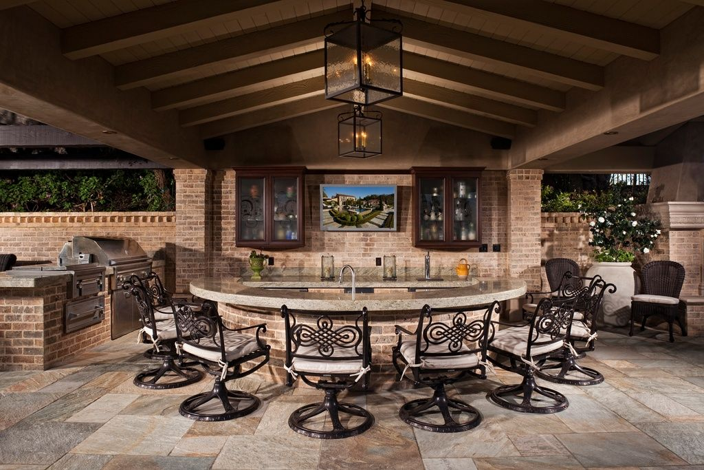 The Perfect Outdoor Kitchen For Any Home. Craftsman Porch With Outdoor  Kitchen, Home Styles Cast Aluminum Rocking Swivel Dining Arm Chair,  Screened Porch.
