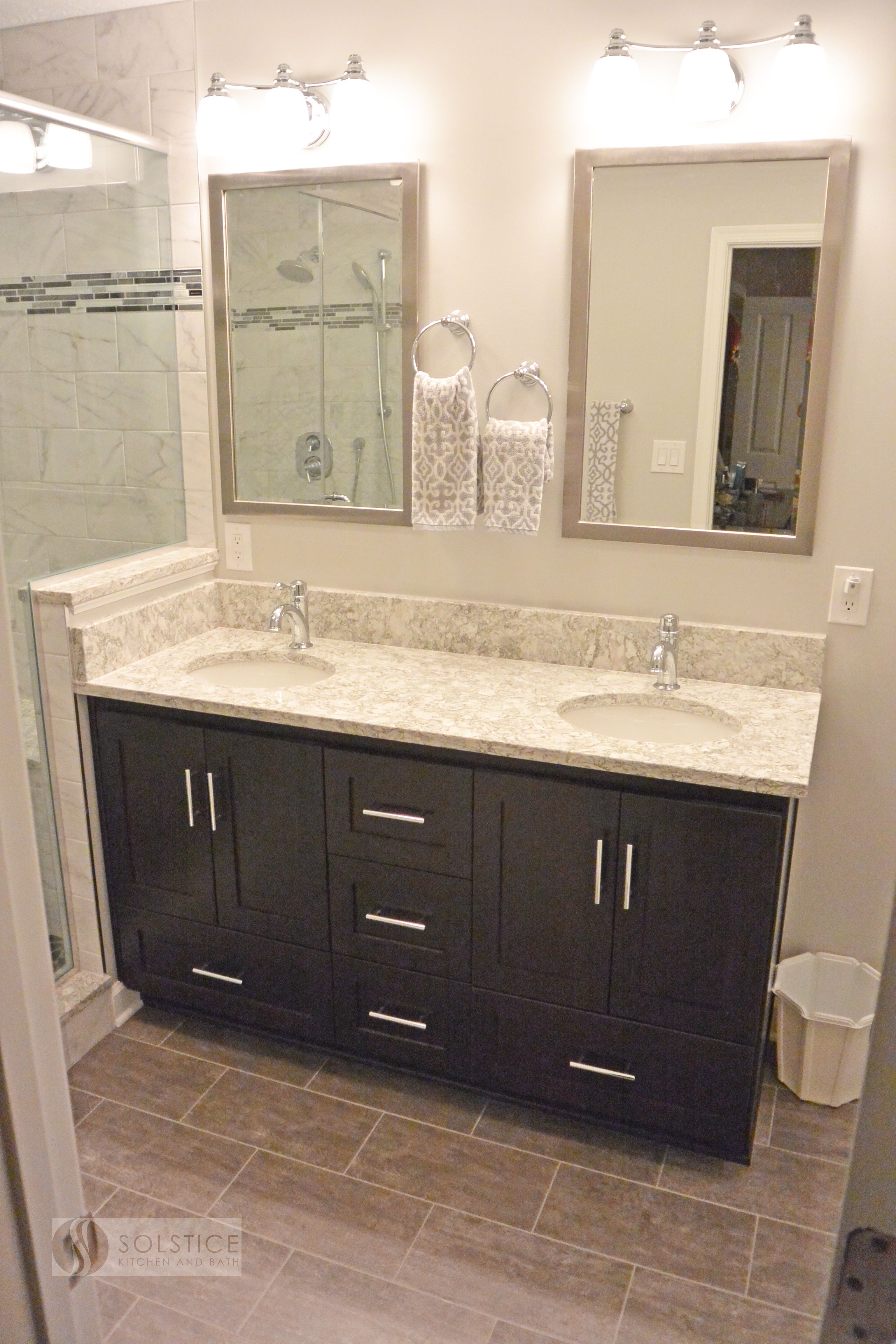 This Warm Transitional Bathroom Design In A Walden Garage Townhome