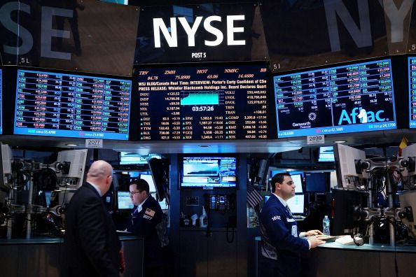 How does the market's record highs reconcile with slow economic growth?