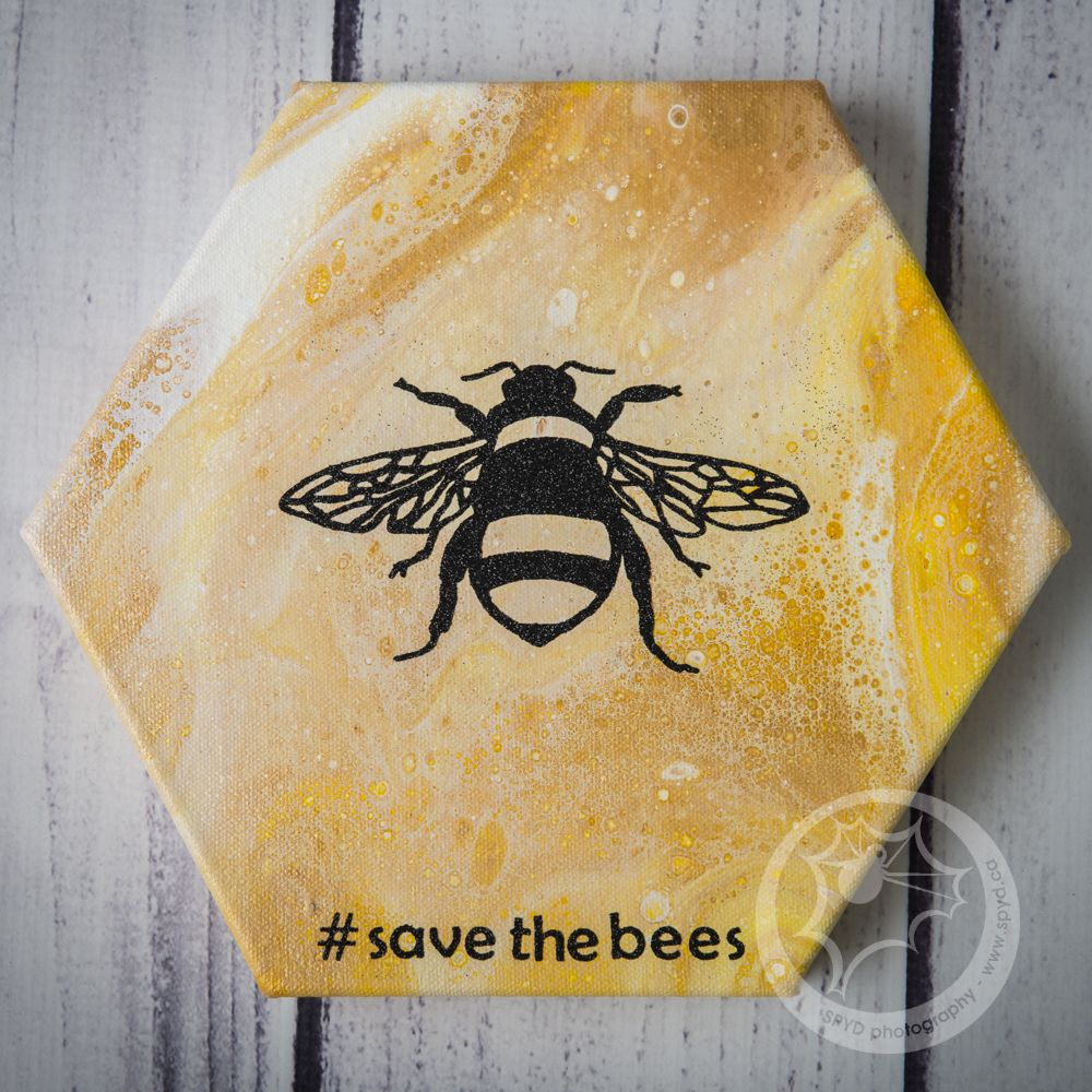 #savethebees acrylic pour with Cricut cut heat transfer glitter vinyl bee.