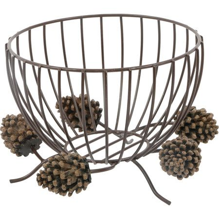 Corral kindling beside the fireplace or display a collection of natural decor in this wire bowl, featuring a pinecone base for a touch of woodland style.