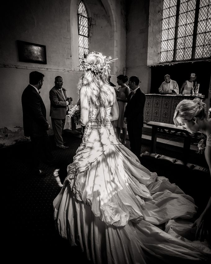 Sunlit bride in church by Andrew Fletcher Wedding images