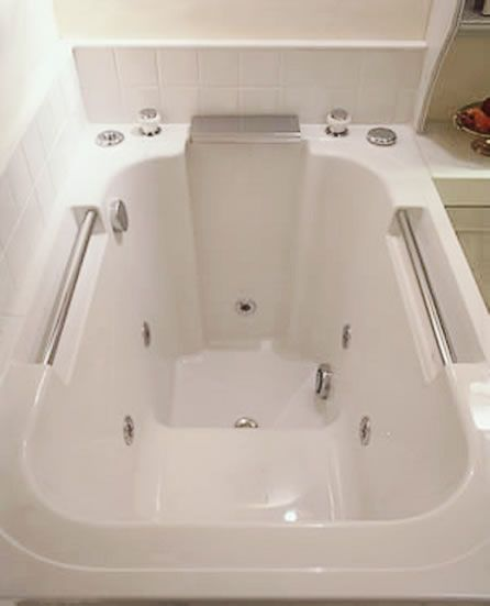 The interior of the Imersa deep soaking tub. This model is shown with a hydrotherapy system.