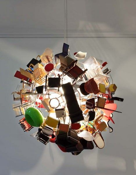Miniature dollhouse-scale versions of classic modern furniture turned into suspended lanterns