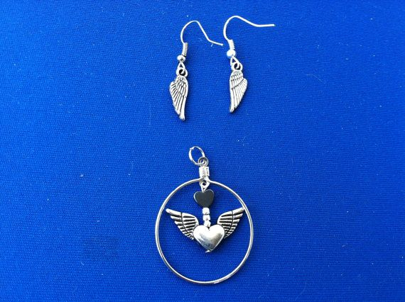 Silver Wings and Heart pendant and by thefalconandtheraven on Etsy, $18.99