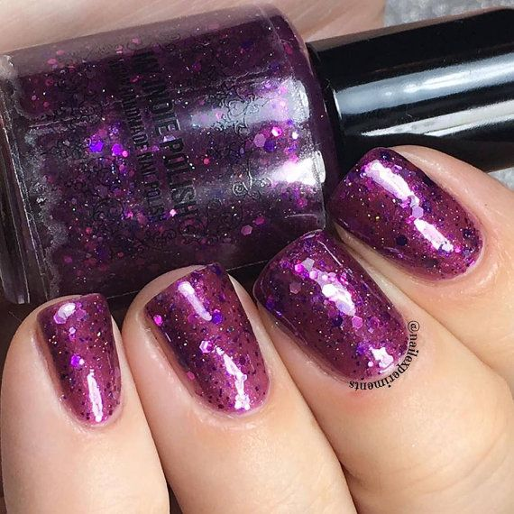 """on sale now Haunter is described as """"a sheer but full coverage purple glitter jelly"""". Shown is three c"""