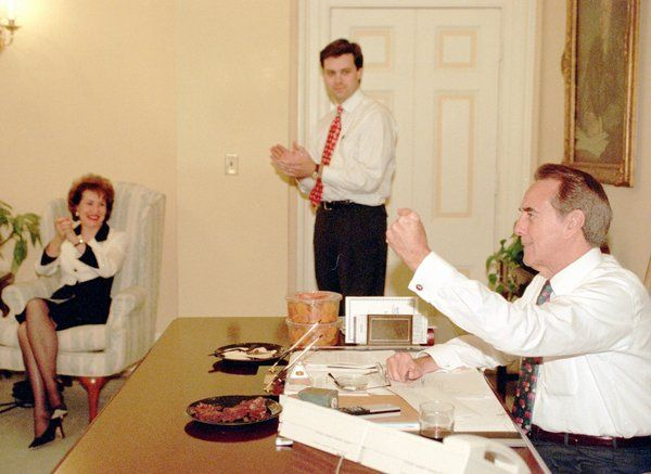SENATE MINORITY LEADER BOB DOLE (R-KS) gestures while watching election returns with his wife Elizabeth and Press Secretary Clarkson Hine (Nov. 8, 1994) in his Capitol Hill office.  Resurgent Republicans sought to take control of Congress for the first time in 40 years.  If Republicans take control of the Senate, Dole would probably become Senate majority leader.
