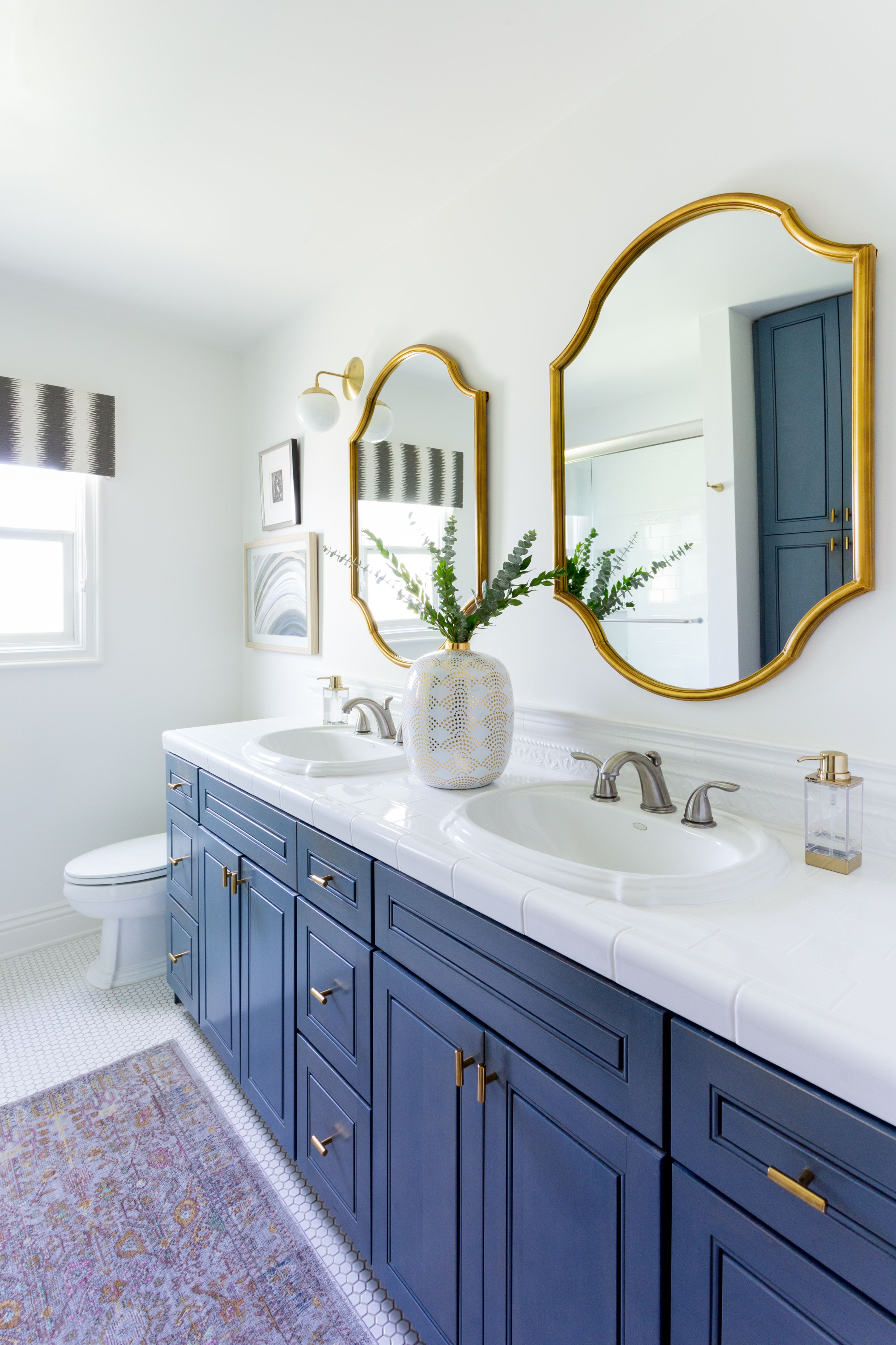 Blue And White Bathroom Gold Framed Mirrors His And Her Sinks Blue Cabinetry Vintage Runner Jen Blue Bathroom Decor Gold Bathroom Decor Gold Bathroom [ 4500 x 3000 Pixel ]