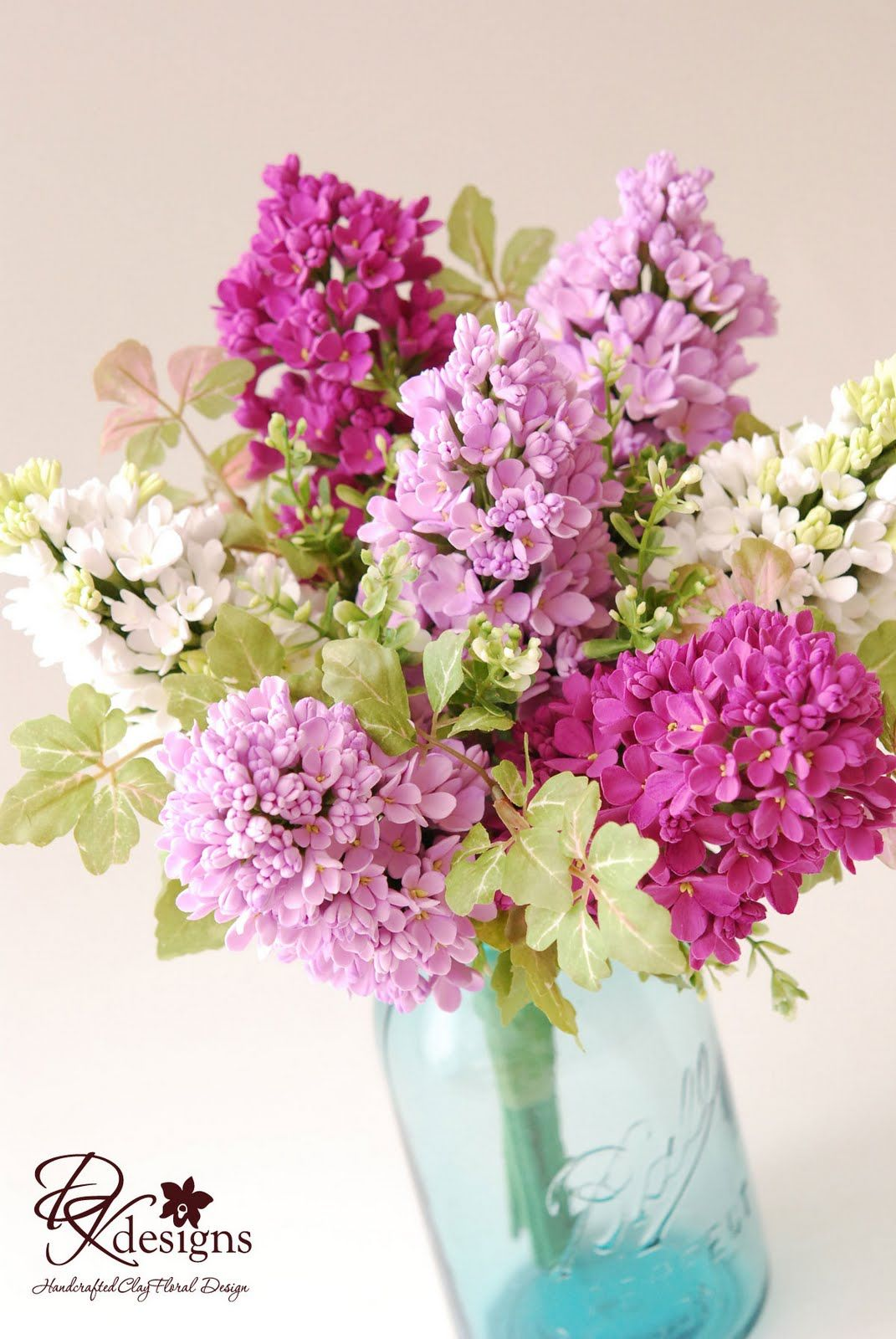 Lilac and ball canning jar centerpiece. I like the lilacs, but could ...