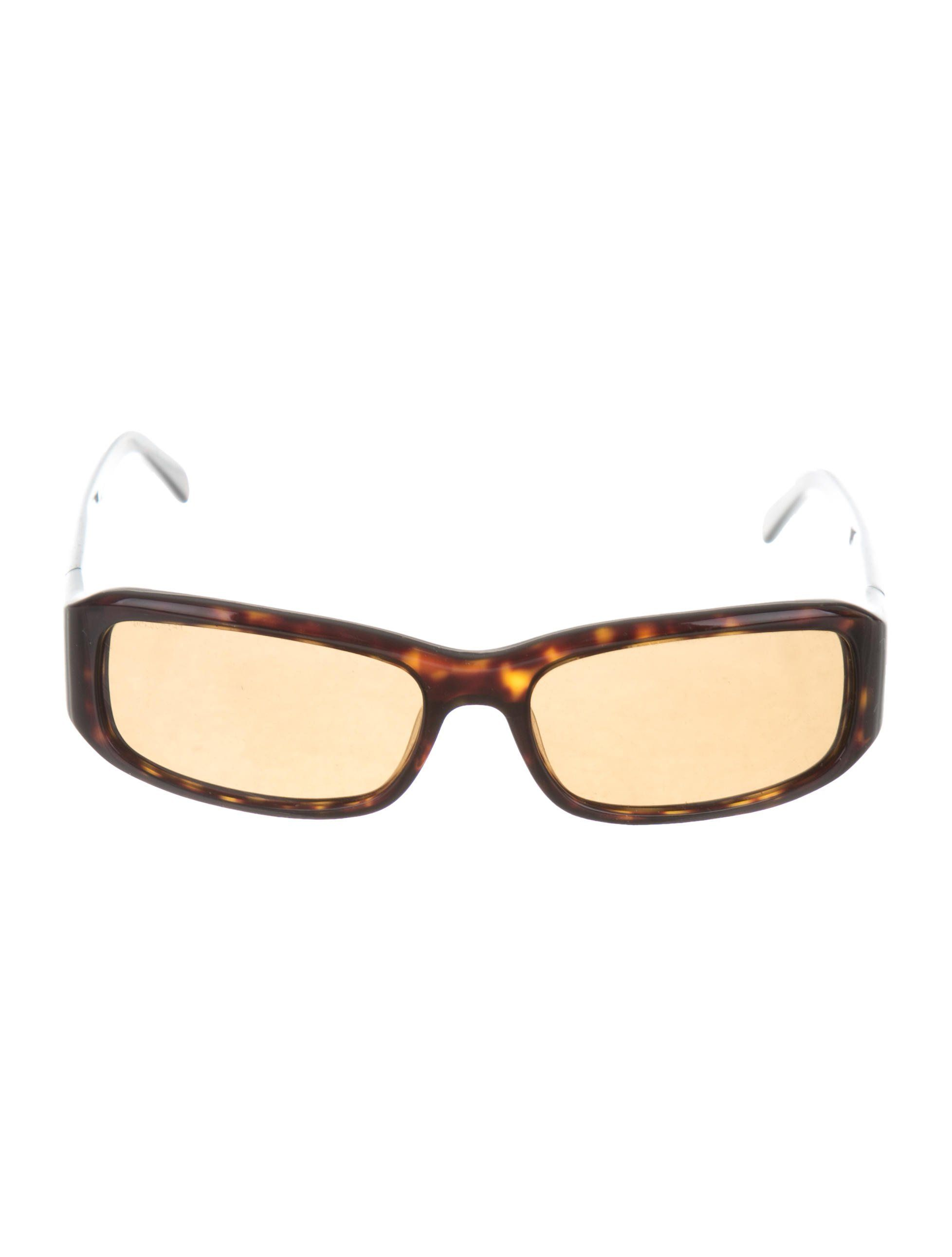 21c1f90e0777f Brown acetate Prada narrow sunglasses with logo at temples and tinted  lenses. Includes case and