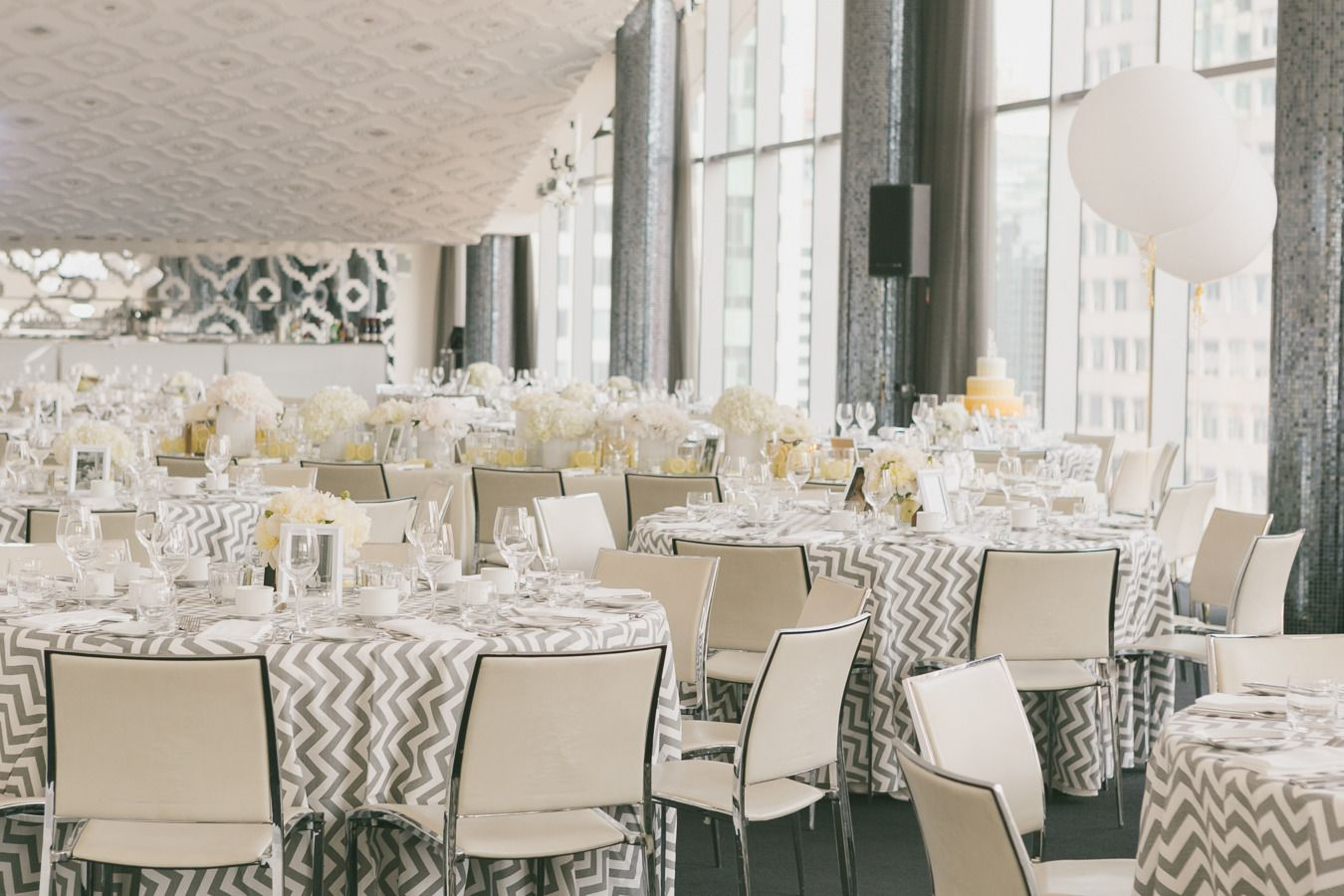Modern tables with chevron linens | Photography: Mango Studios - mangostudios.com  Read More: http://www.stylemepretty.com/canada-weddings/2014/04/22/modern-gray-and-yellow-wedding-at-malaparte/