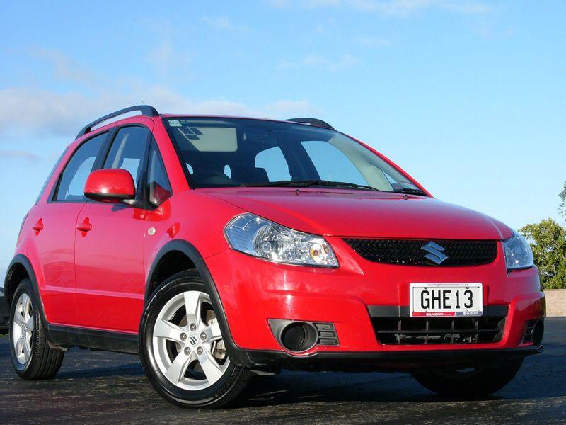 Red Suzuki SX4 www.gilmourmotors.co.nz/usedcars Used