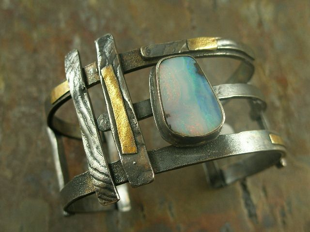 American designed one of a kind sterling silver, 22k. gold and natural boulder opal contemporary cuff statement bracelet at adornedbylonnie.com