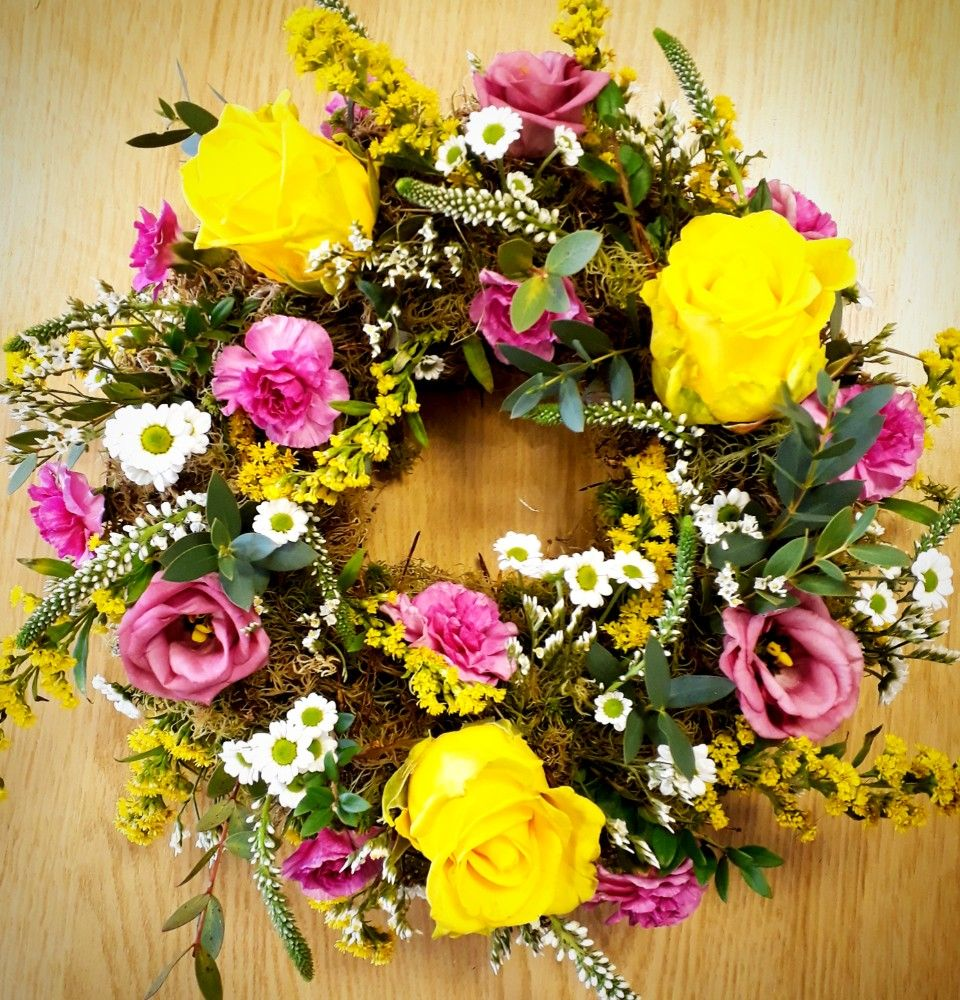 Beautiful spring wreath completed as a funeral tribute for
