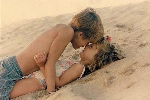 beach girl kiss Young boy