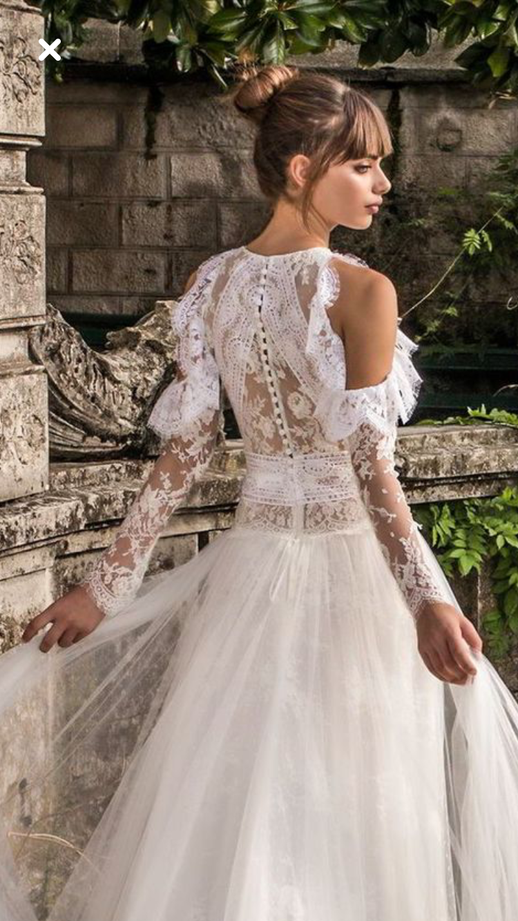 The exposed shoulder on this lacy wedding gown gives it a fresh and ...