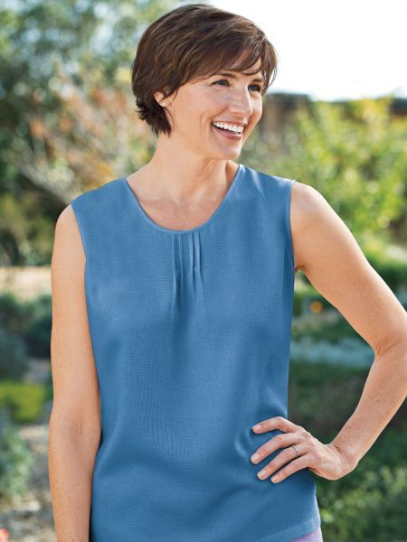 Travel clothing with easy style, this Women's Packable Silk Tank sheds wrinkles and packs like a dream. Also in petites and plus size.