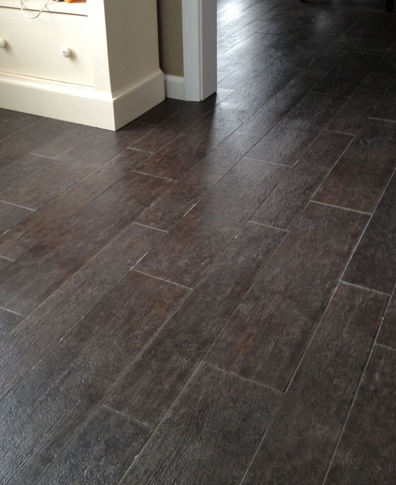 Marazzi tile planks yes its tile not hardwood in ebony for Hardwood floors in bathroom