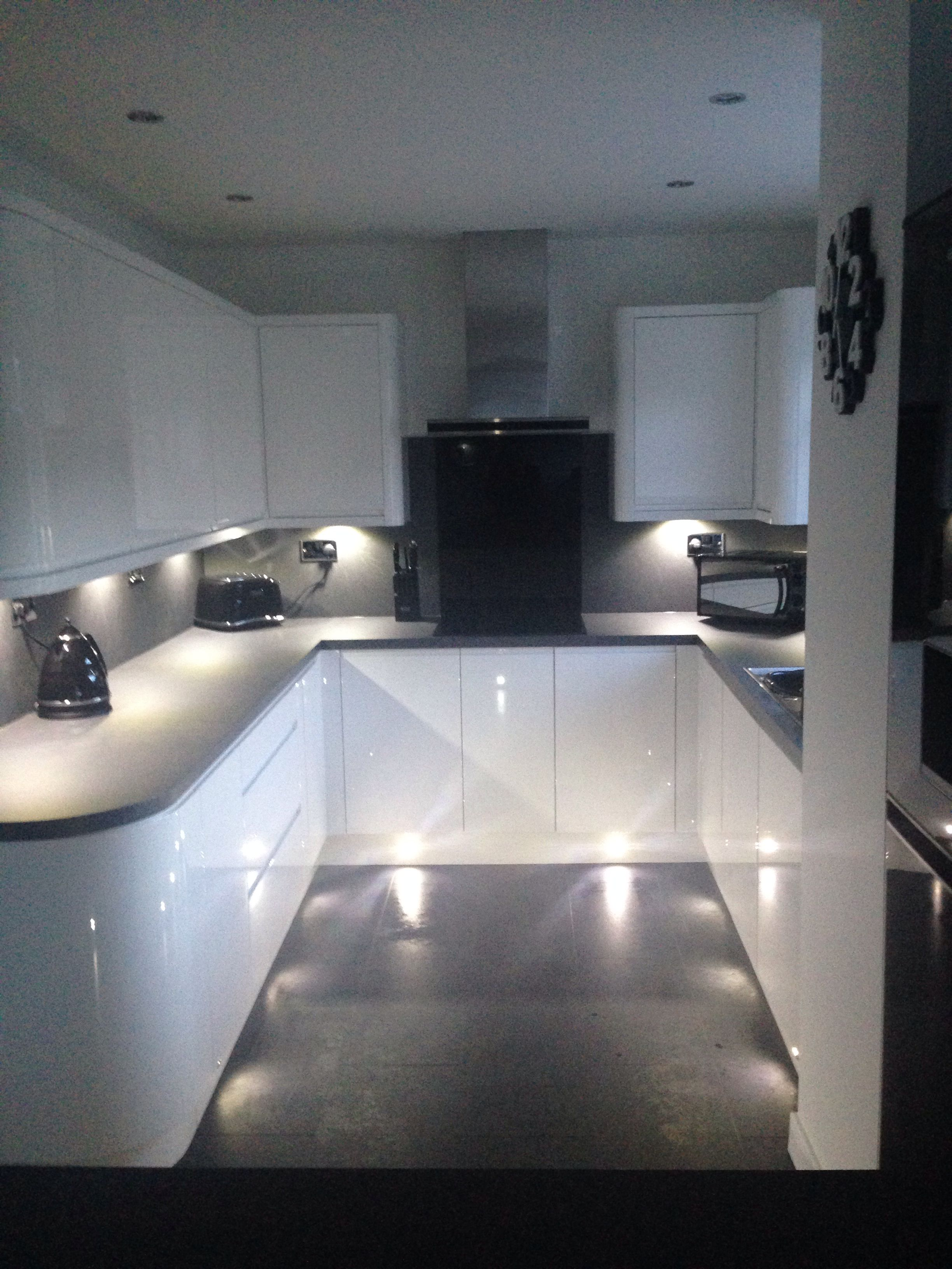 White Gloss Handless Wren Kitchen With Curves Grey Slate Work Top And Flooring Tech Wall