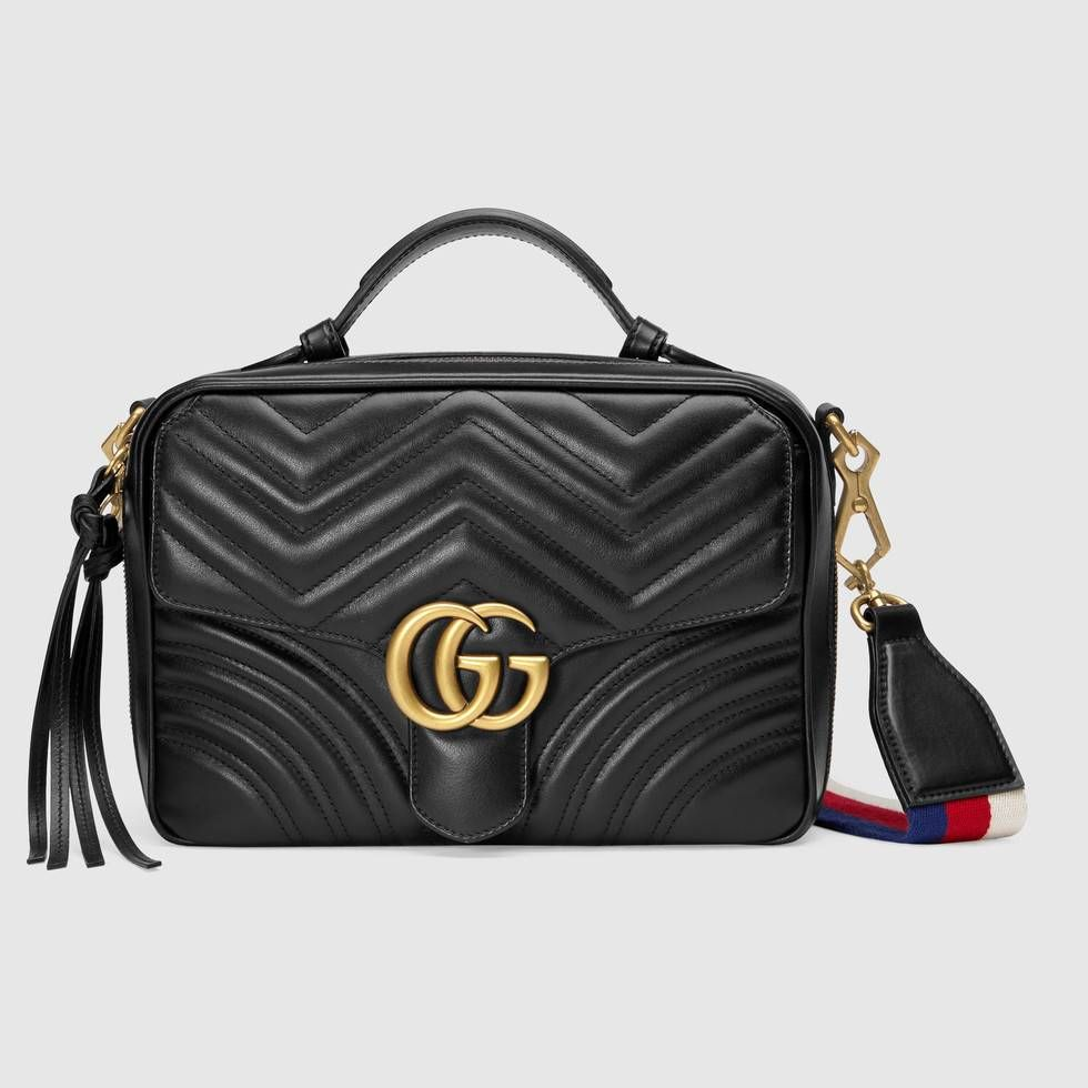 1645c40760b6 The GG Marmont shoulder bag has a softly structured shape with zip around  closure and an oversized front flap with Double G hardware.