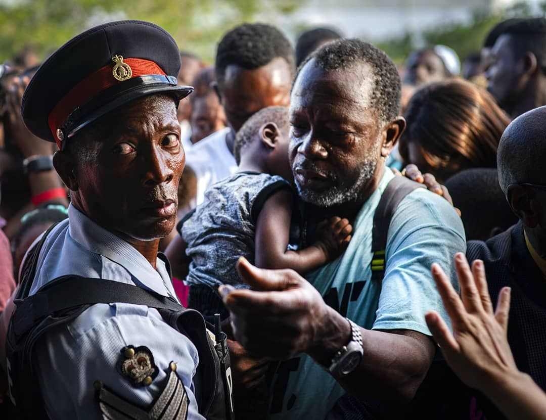 Bahamas Hurricane Dorian A police officer stands guard as Haitian migrants waiting to get food distributed by humanitarian organizations in Nassau, Bahamas, Sunday, Sept. 29, 2019. A preliminary report estimates Dorian caused some $7 billion in damage, but the government has not yet offered any figures. (AP Photo/Ramon Espinosa)@apnews #bahamas #hurricanedorian #haiti #immigration #humanitarian #food ##police #photooftheday #photojournalism #sonya9 #hurricanefoodideas