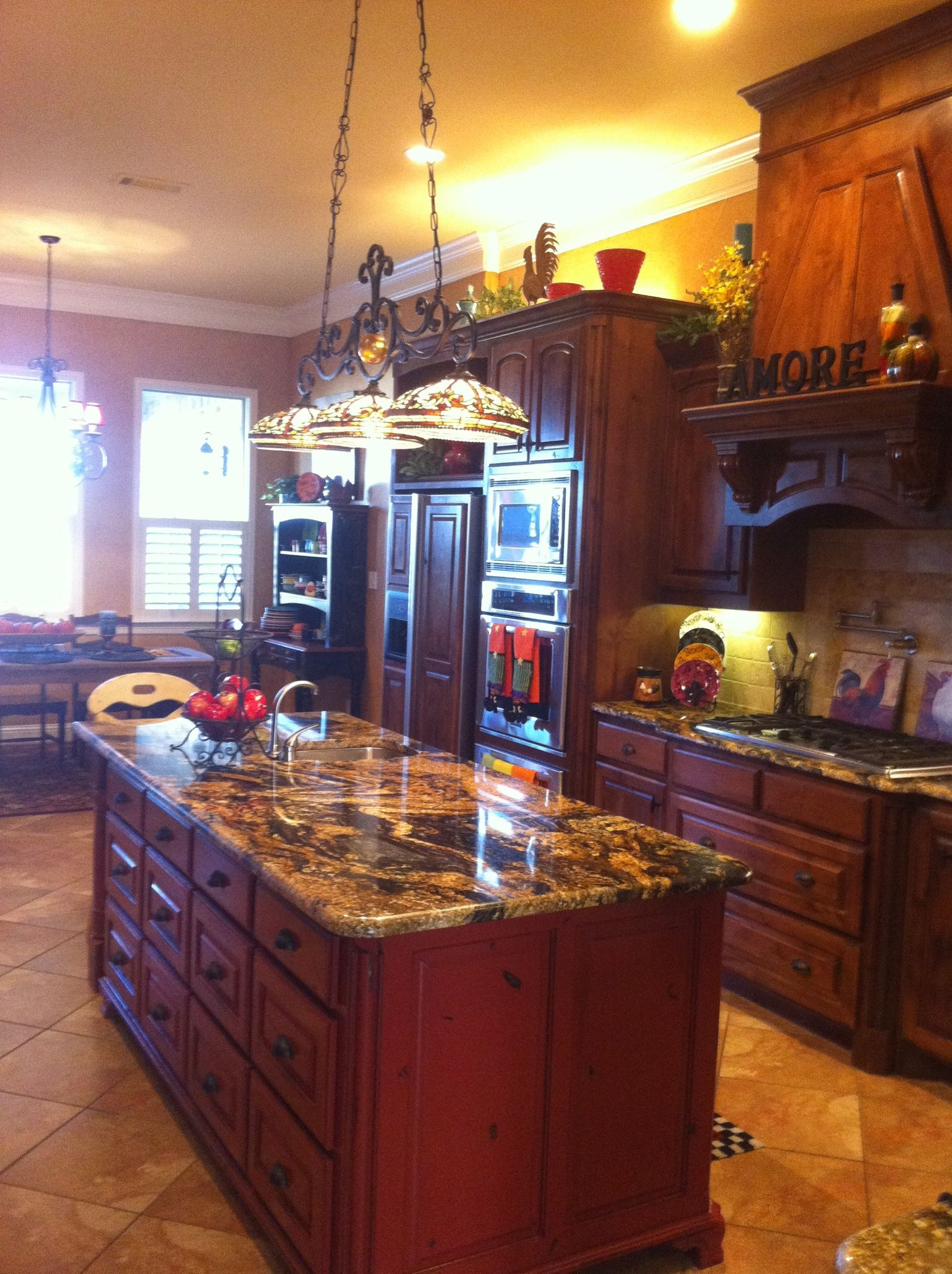 Kitchen With Tiffany Light Over Island