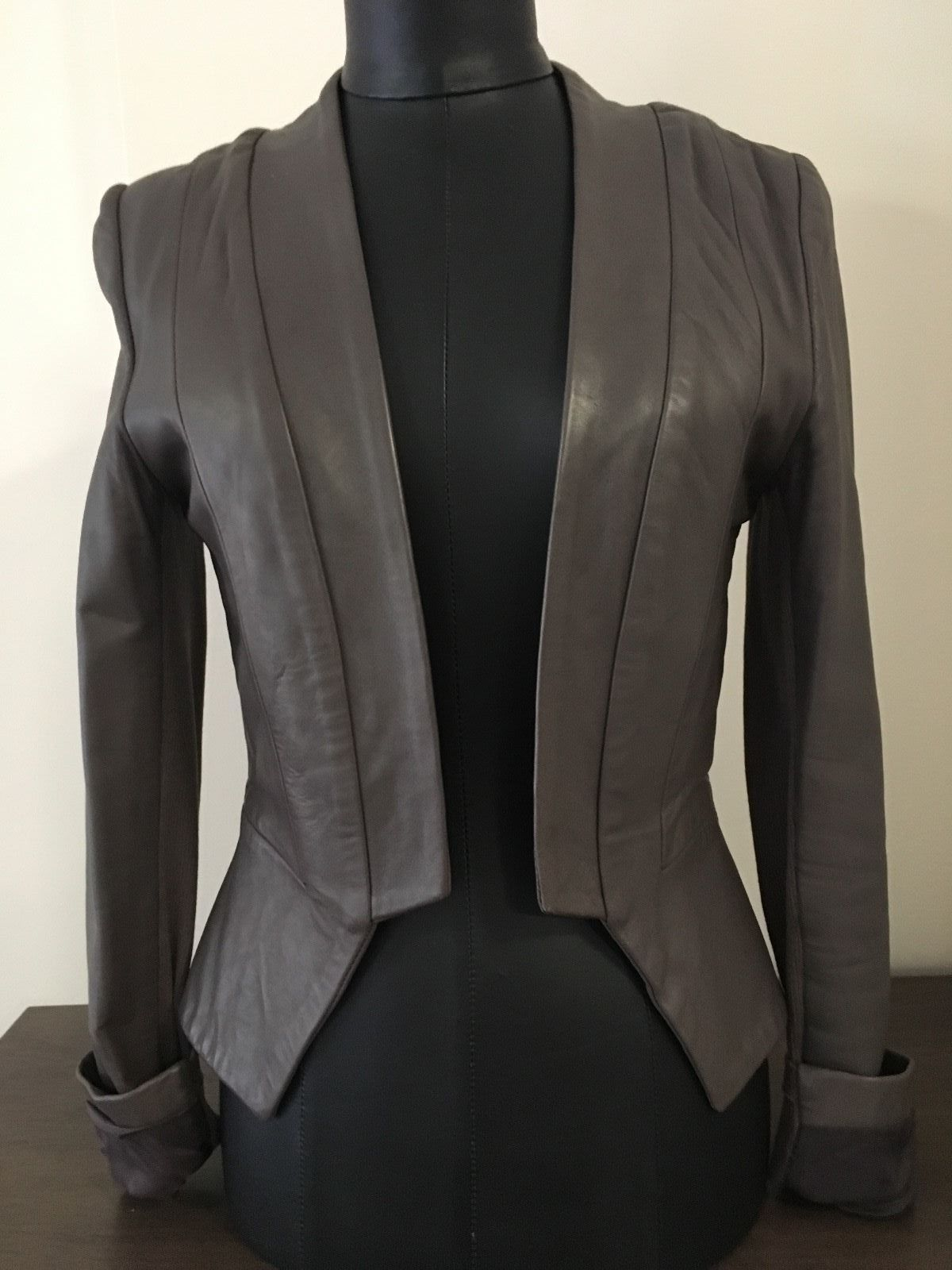100 Lamb Leather, made in Australia. No front closure