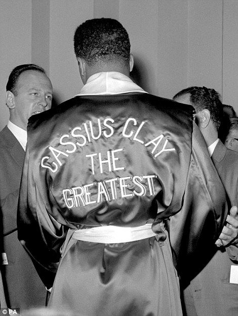 Ali, then known as Cassius Clay, in 1963 at the weigh in for his fight with British boxer Henry Cooper