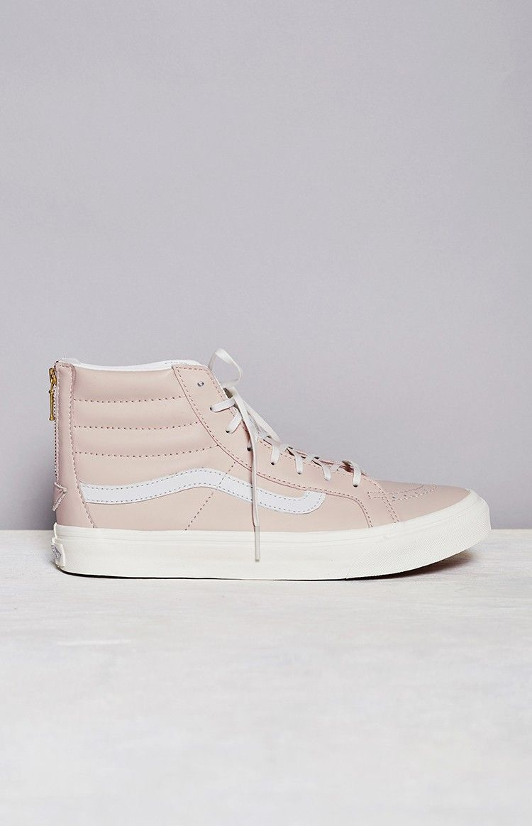 c4713ad09236e2 Skater girls can be girly too in the Vans Sk8-Hi Slim Zip Leather Pink  sneakers! Made from a premium