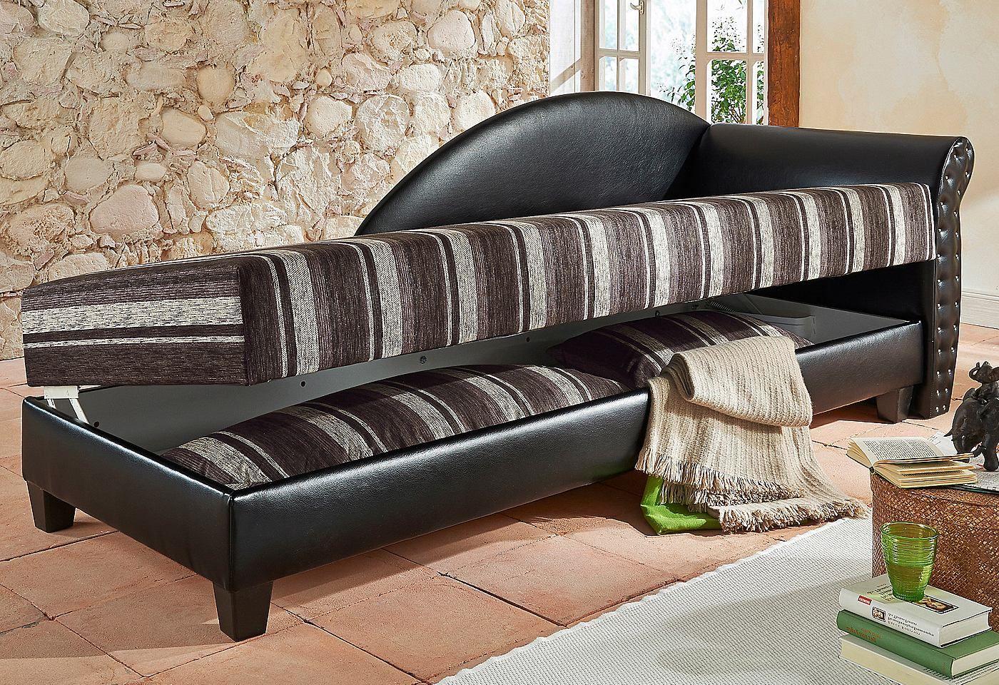Sitzfläche in strapazierfähigem Microvelours (100% Polyester). Korpus braun = Sitzfläche braun/beige. Korpus schwarz = Sitzfläche schwarz/beige.  Maße Liegefläche 80/200 cm, Liegehöhe 45 cm. Geräumiger Bettkasten sorgt für mehr Stauraum, Stauraumhöhe 15 cm. Höhe der Holzfüße 9 cm. Außenmaße (B/T/H): 227/83/81 cm.  Unser TIPP: Bestellen Sie gleich die passenden Kissen im 2er-Set dazu (braun/beig...
