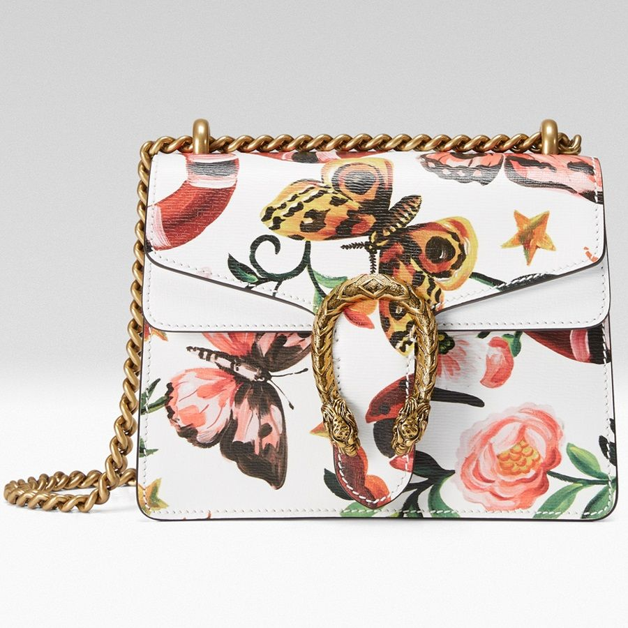 fe3f9dee231 Shop the Dionysus GG Supreme mini bag by Gucci. A mini structured bag with  our textured tiger head spur closure. The sliding chain strap can be worn  ...