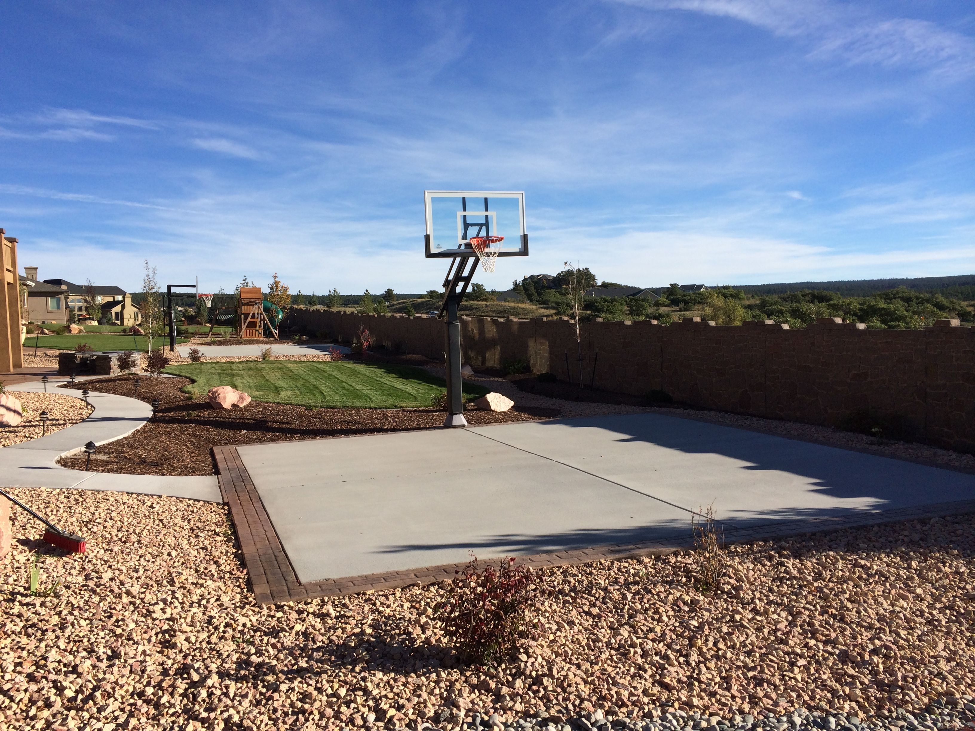 This is a great picture of a backyard basketball court ...