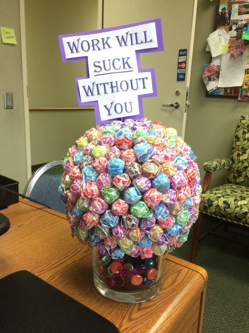 Coworker leaving dum dum bouquet gift for coworker