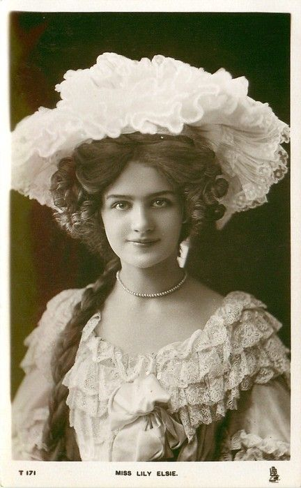 MISS LILY ELSIE head & shoulders, facing & looking front, lace trim to hat & top of dress