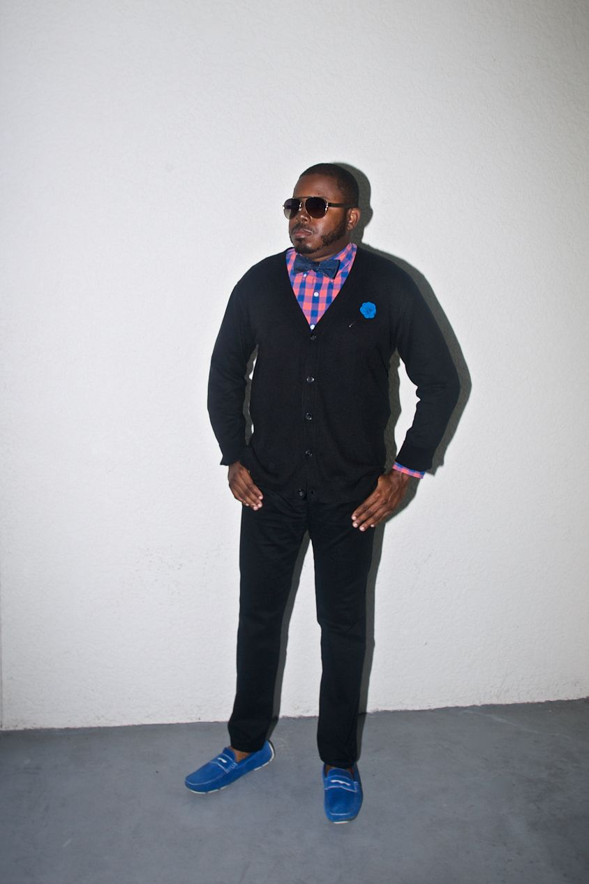 Black sweater and pants with a pink and blue shirt, blue bow tie ...